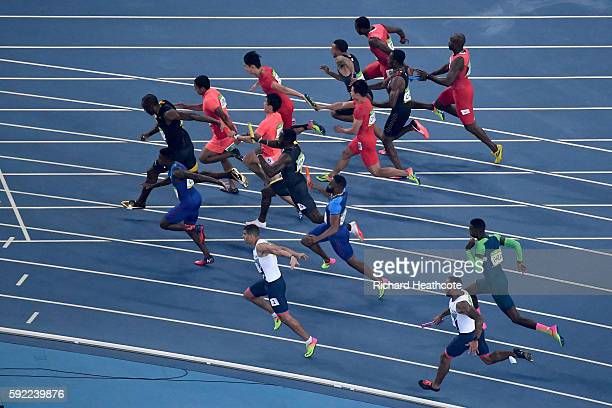 Batons are passed to Usain Bolt of Jamaica Aska Cambridge of Japan and Trayvon Bromell of the United States in the Men's 4 x 100m Relay Final on Day...
