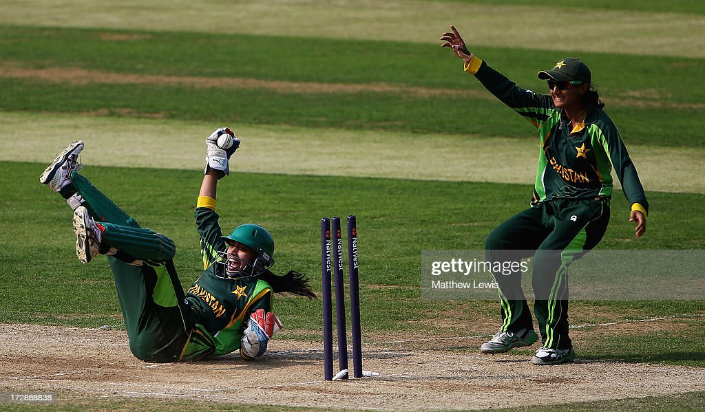 Batool Fatima (L) of Pakistan celebrates running out Susie Rowe of England during the 2nd NatWest Women's International T20 match between England Women and Pakistan Women on July 5, 2013 in Loughborough, England.