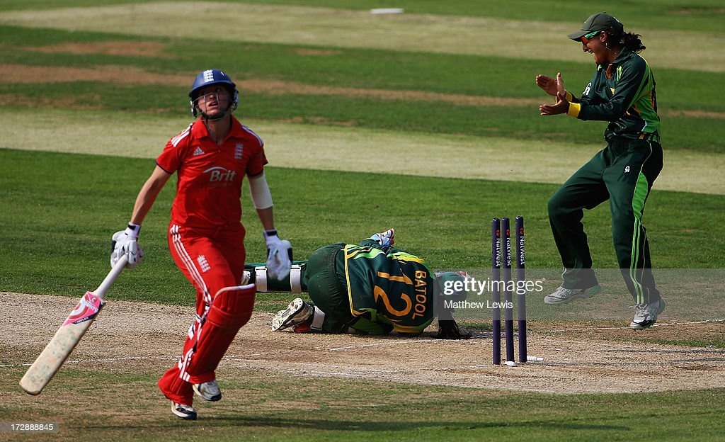 Batool Fatima (C) of Pakistan celebrates running out Susie Rowe of England during the 2nd NatWest Women's International T20 match between England Women and Pakistan Women on July 5, 2013 in Loughborough, England.