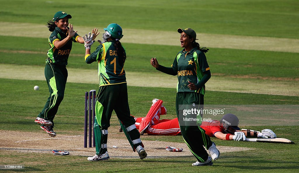 Batool Fatima of Pakistan is congratulated by team mates, after she ran out Arran Brindle of England during the 2nd NatWest Women's International T20 match between England Women and Pakistan Women on July 5, 2013 in Loughborough, England.