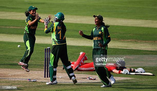 Batool Fatima of Pakistan is congratulated by team mates after she ran out Arran Brindle of England during the 2nd NatWest Women's International T20...