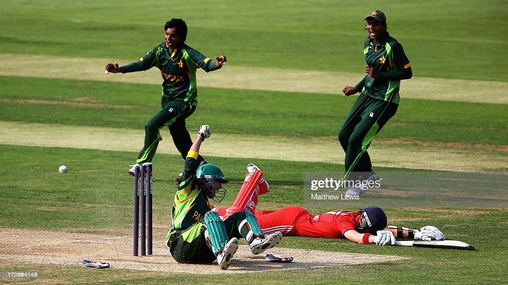 Batool Fatima of Pakistan runs out Arran Brindle of England during the 2nd NatWest Women's International T20 match between England Women and Pakistan Women on July 5, 2013 in Loughborough, England.