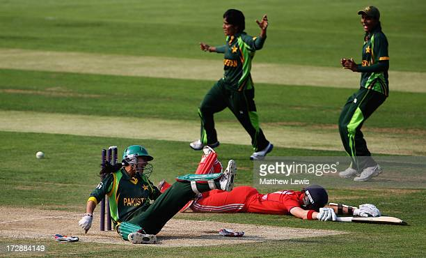 Batool Fatima of Pakistan runs out Arran Brindle of England during the 2nd NatWest Women's International T20 match between England Women and Pakistan...