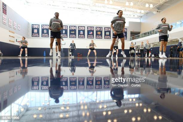 Batouly Camara Napheesa Collier and Gabby Williams of the UConn Huskies warming up with teammates under the supervision of strength coach Amanda...