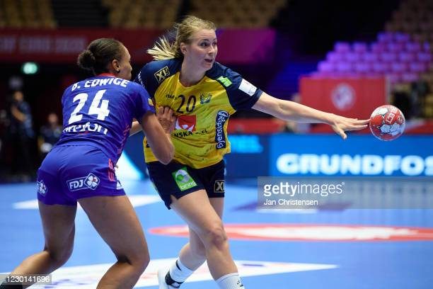 Béatrice Edwige of France and Isabelle Gulldén of Sweden challenge for the ball during the Women's EHF EURO 2020 match beween France and Sweden in...