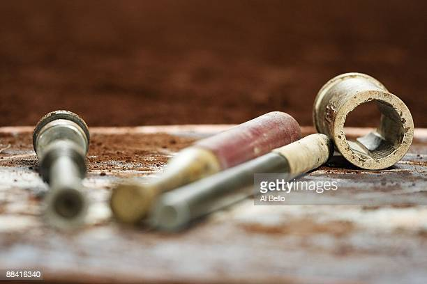 Bats and batting weights lay in the on deck circle during the game between the New York Mets against the Philadelphia Phillies during their game on...
