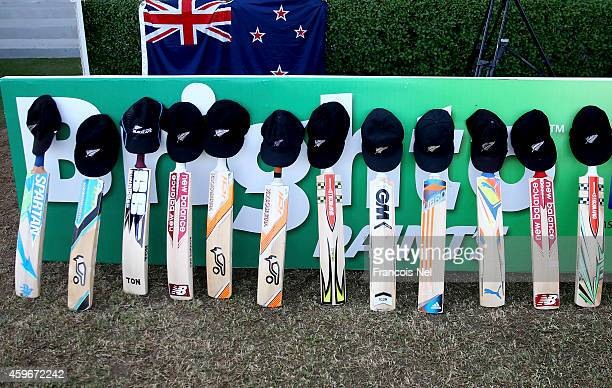 Bats and caps are placed outside the New Zealand dressing room in memory of Australian cricketer Phillip Hughes who died as a result of head injuries...