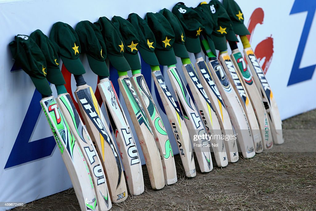 Bats and caps are placed outside the Pakistan dressing room in memory of Australian cricketer Phillip Hughes who died as a result of head injuries sustained during the Sheffield Shield match between South Australia and New South Wales at the SCG on Tuesday, during day two of the third test between Pakistan and New Zealand at Sharjah Stadium on November 28, 2014 in Sharjah, United Arab Emirates.