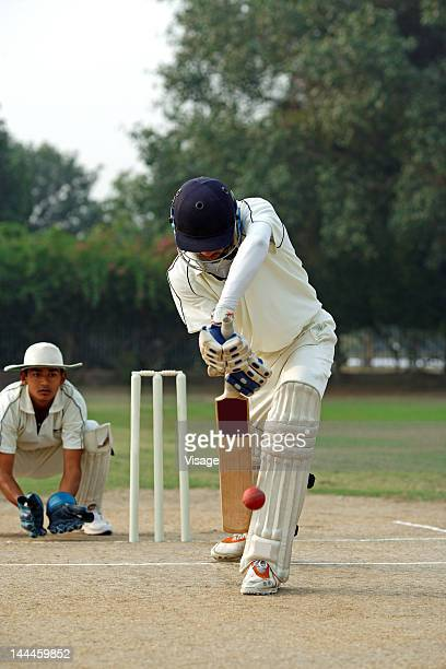 Batsman defending a ball