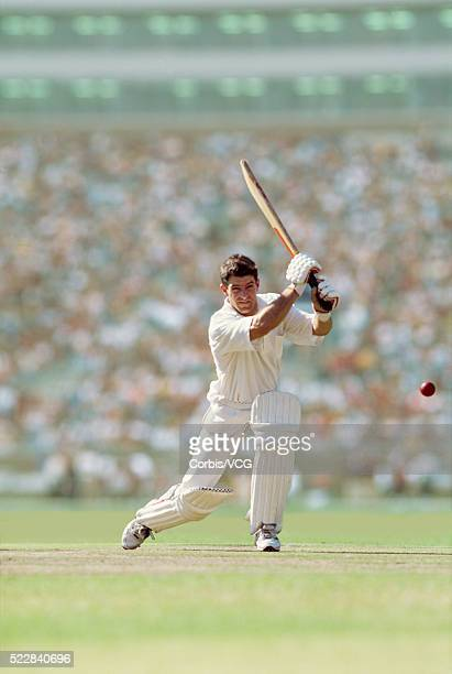 a batsman defending his wicket - cricket player stock photos and pictures