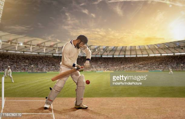 batsman in action in a cricket match - batsman stock pictures, royalty-free photos & images