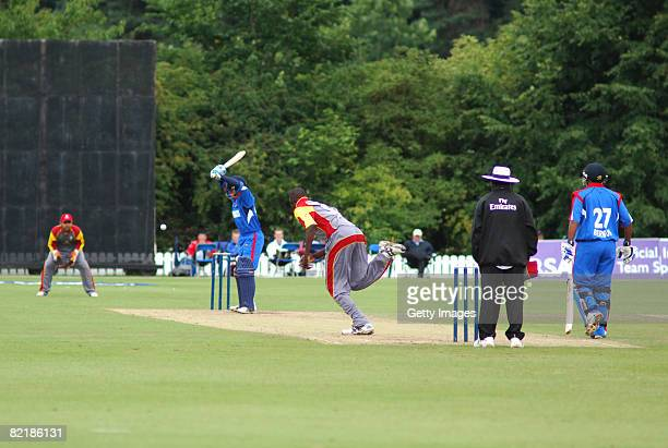 Batsman Jekon Edness of Bermuda lets a ball from Canada's Henry Osinde pass during the Canada v Bermuda ICC Twenty20 World Cup Qualifying match at on...