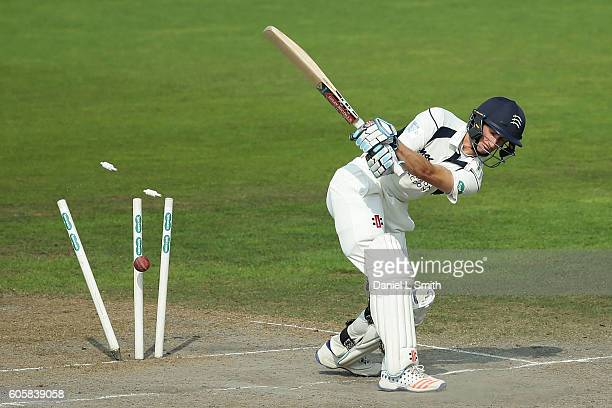 Batsman John Simpson of Middlesex is bowled by Luke Procter of Lancashire during day four of the Specsavers County Championship Division One match...