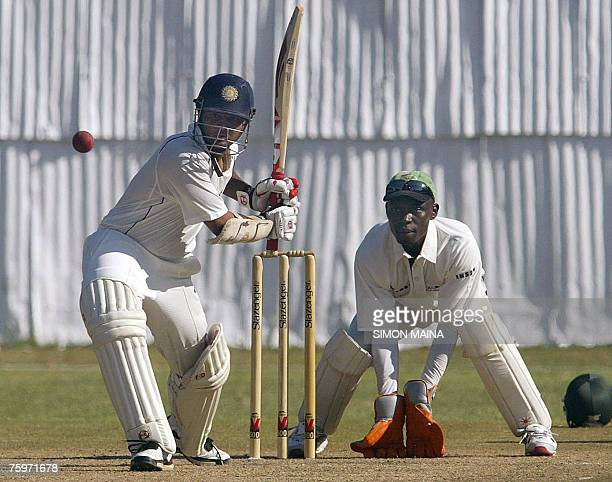 Batsman Parthiv Patel of India hits the last runs to reach a century as Kenya's wicketkeeper Maurice Ouma prepares for a catch 05 August 2007 during...