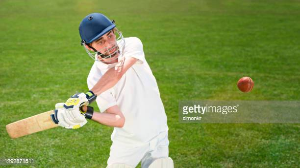 batsman playing cricket - cricket ball stock pictures, royalty-free photos & images