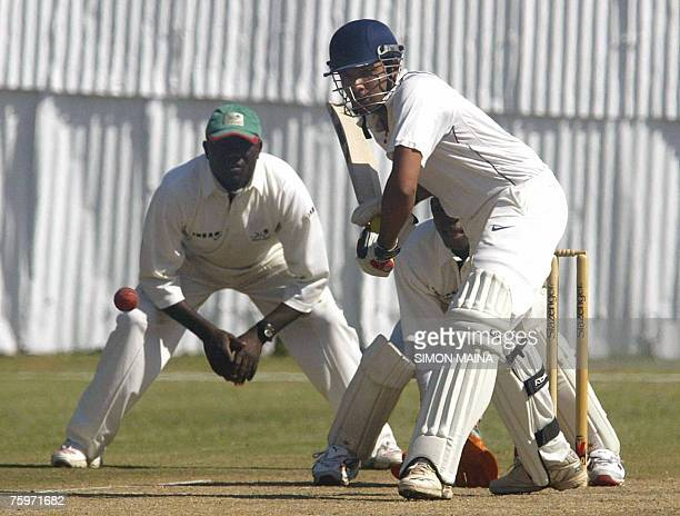 Batsman Rohit Sharma of India hits out against Kenya's bowler Jimmy Kamande as wicketkeeper Steve Tikolo awaits for the catch 05 August 2007 during a...