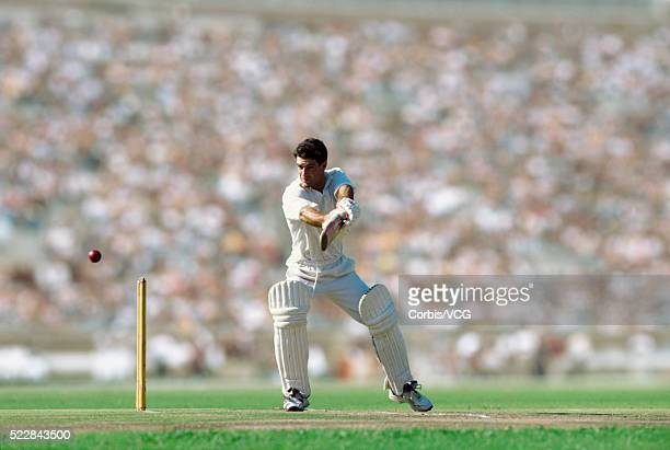 a batsman standing at the wicket, watching the ball behind him - cricket stock pictures, royalty-free photos & images