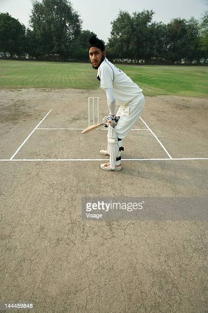 Batsman taking his position on the pitch