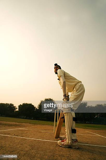 batsman taking his position on the pitch - crease cricket field stock pictures, royalty-free photos & images