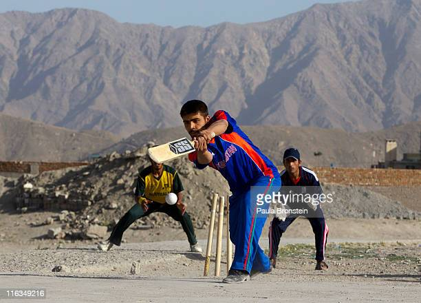 A batsman tries to hit the ball during a neighborhood cricket game June 15 2011 in Kabul Afghanistan Cricket enthusiasm continues to grow as Out of...