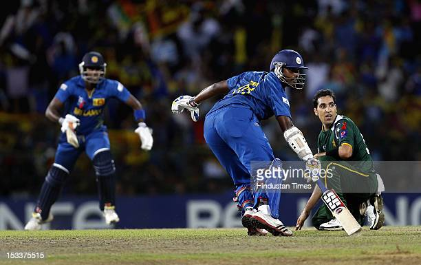 Batsmen Thisara Perera and Ajantha Mendis of Sri Lanka run between the wicket as bowler Umar Gul of Pakistani looks on during the ICC T20 World Cup...