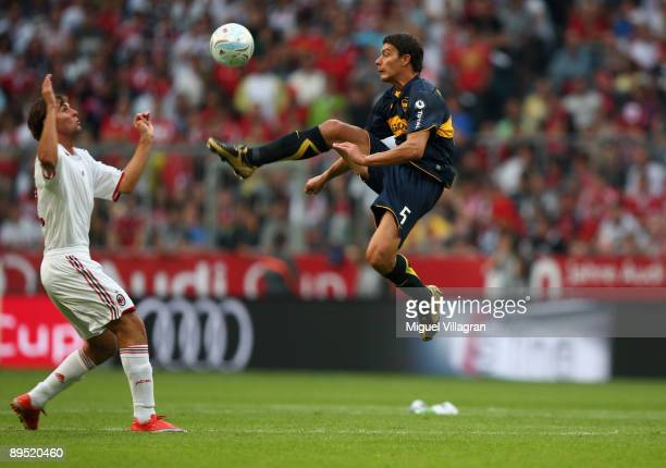 Battaglia of Boca Juniors and Gianmarco Zigoni of AC Milan challenge for the ball during the Audi Cup tournament match between Boca Juniors v AC...