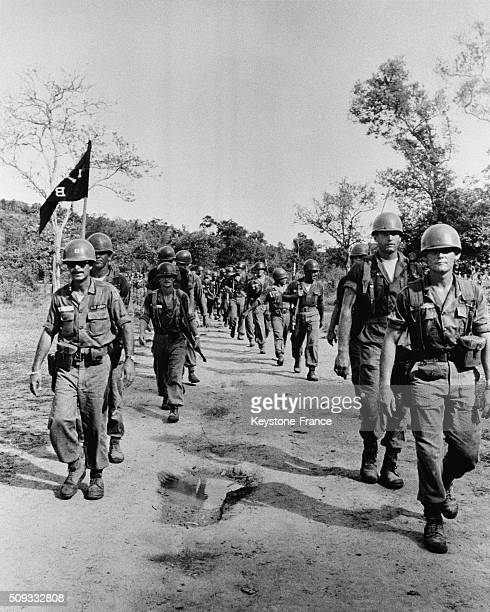 Battalion Of The 27th Infantry Battle Group Of Wolfhound Division Move Along A road On Their Way To Wake Up Defensive Positions On Thai Laos Border...