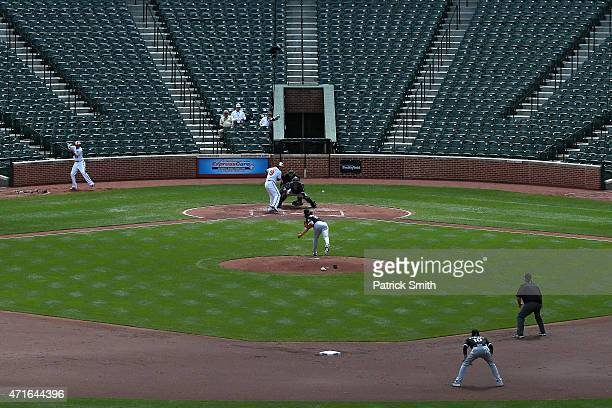 Batter Chris Davis of the Baltimore Orioles hits a three-run home run off of starting pitcher Jeff Samardzija of the Chicago White Sox in the first...