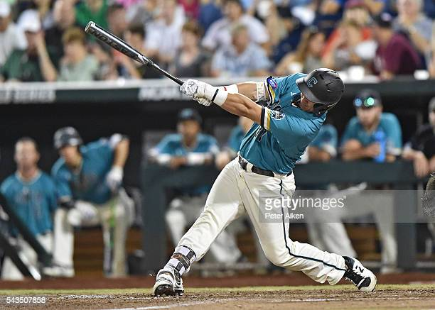 Batter GK Young of the Coastal Carolina Chanticleers drives in two runs with a single against the Arizona Wildcats in the seventh inning during game...