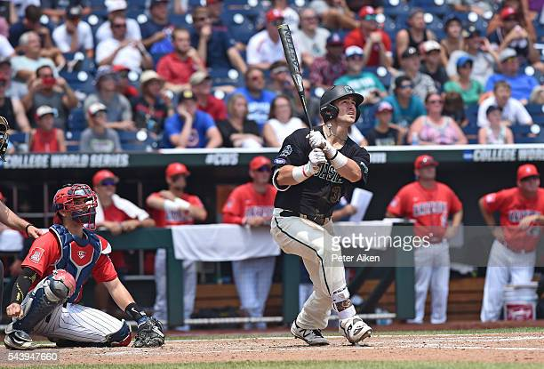 Batter GK Young of the Coastal Carolina Chanticleers hits a tworun home run against the Arizona Wildcats in the sixth inning during game three of the...