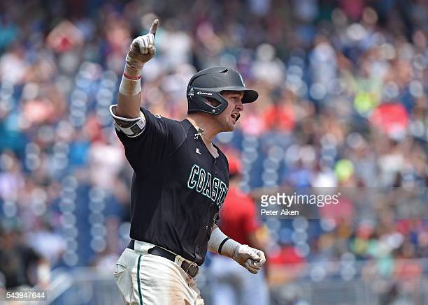 Batter GK Young of the Coastal Carolina Chanticleers reacts after hitting a tworun home run against the Arizona Wildcats in the sixth inning during...