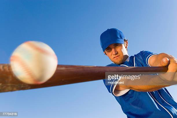 batter hitting baseball - batting stock pictures, royalty-free photos & images