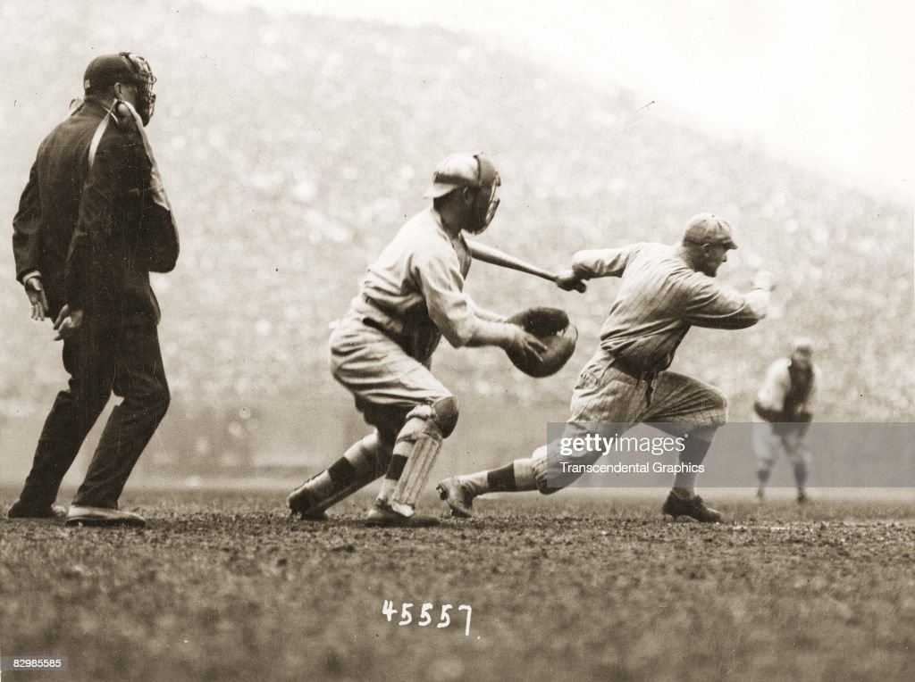 Batter Hy Myers of the Brooklyn Robins has just launched an inside the park home run in the first inning of Game 2 of the 1916 World Series against the Boston Red Sox at Fenway Park on October 9, 1916 in Boston, Massachusetts. The catcher is Pinch Thomas.