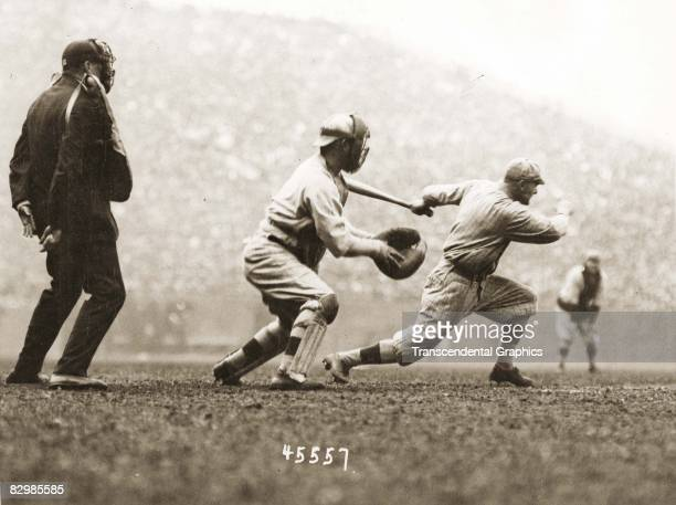 Batter Hy Myers of the Brooklyn Robins has just launched an inside the park home run in the first inning of Game 2 of the 1916 World Series against...
