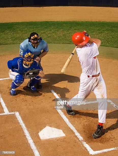 batter swinging at a pitch - キャッチャー ストックフォトと画像
