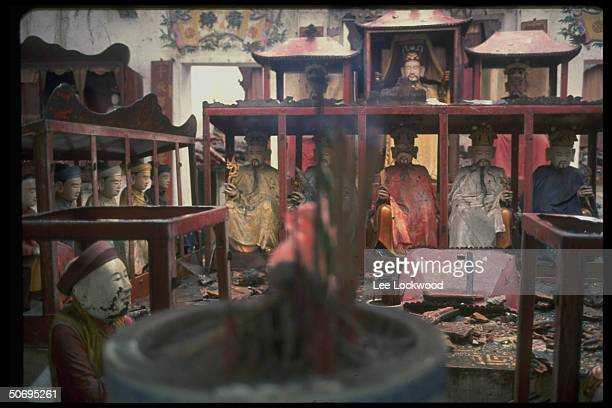 Battered Buddhist images are remains of a bombing raid levelling block of buildings
