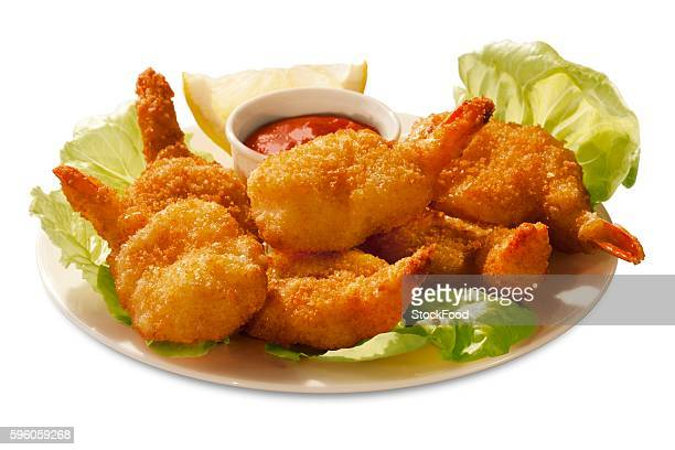 battered butterflied shrimp with dipping sauce - breaded stock photos and pictures