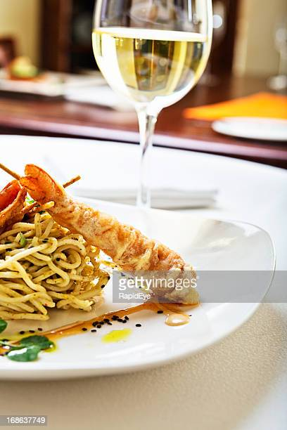 Battered,  crispy prawns with noodles and white wine