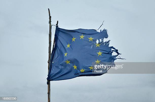 Battered European Union flag in strong winds