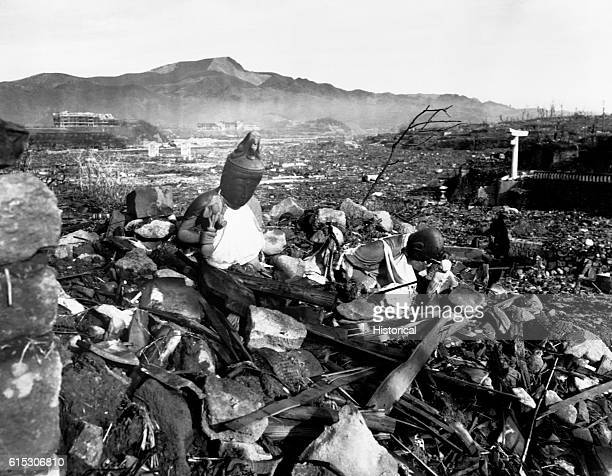 Battered religious figures rest among the rubble of Nagasaki after the atomic bombing of the city by American armed forces on August 9, 1945.