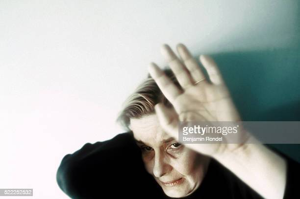 Battered woman raising her hand in self-defense