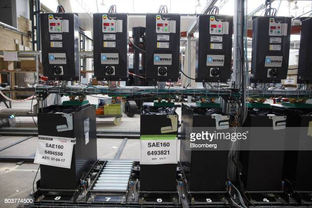 Batteries for mobile robots also known as an AGV or automated guided vehicle charge before use inside the Automatismos y Sistemas de Transporte...