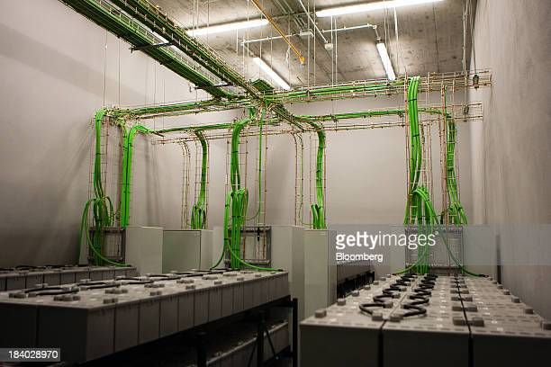 Batteries sit connected to green wiring inside one of the twelve power backup rooms at Portugal Telecom SGPS SA's new data center in Covilha Portugal...