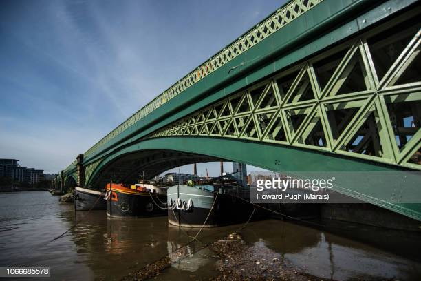 Battersea Bridge. Moored under the arches.