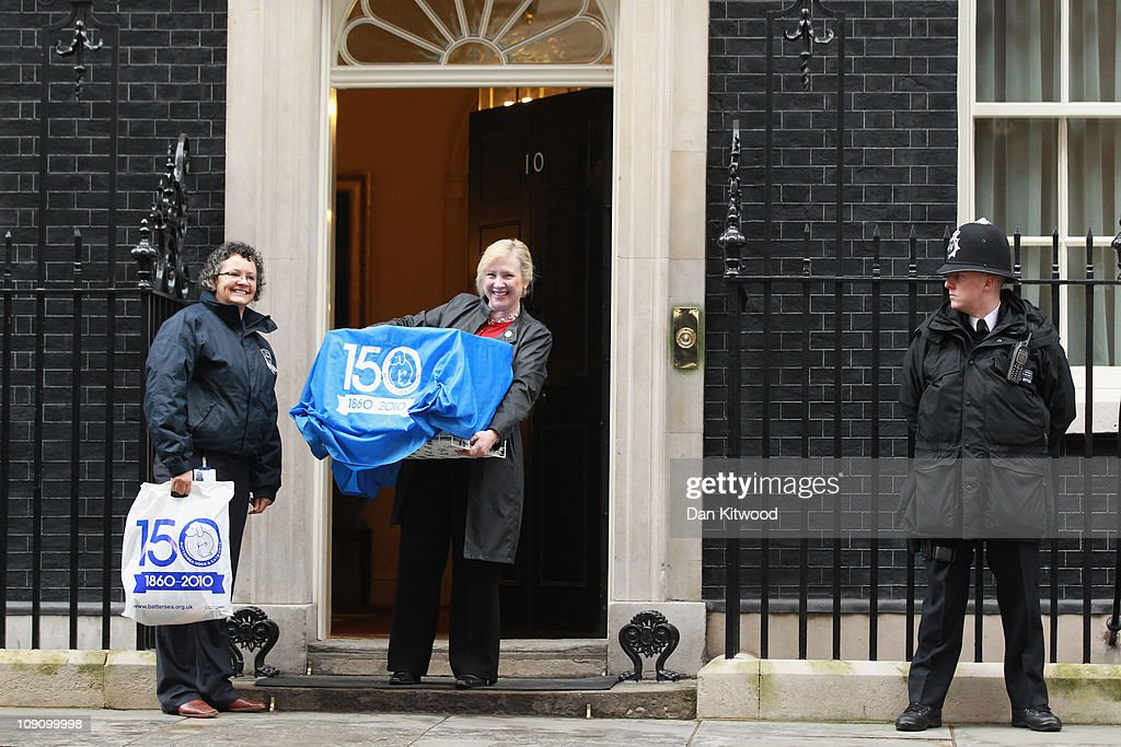 Battersea Dogs and Cats home CEO, Claire Horton delivers 'Larry', the new Downing Street cat, to 10 Downing Street, on February 15, 2011 in London, England. It is hoped that British Prime Minister David Cameron's newest team member Larry, will dispense of a rat that has been spotted scuttling past the famous door of Number 10 Downing Street in recent weeks.