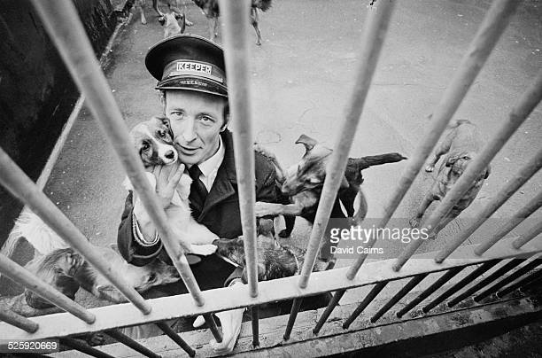 Battersea Dogs Home keeper Charles Levin holding the 16000th abandoned dog of the year London 1969