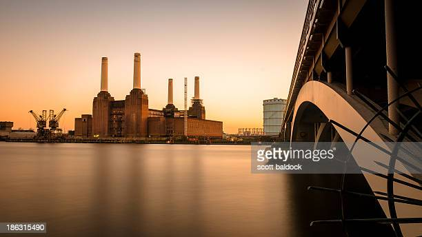 Battersea power station London at sunset with Chelsea bridge and river thames
