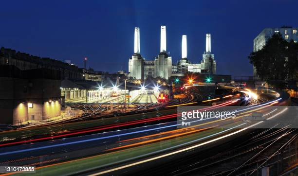 battersea power station with subway traffic (london, uk) - transportation stock pictures, royalty-free photos & images