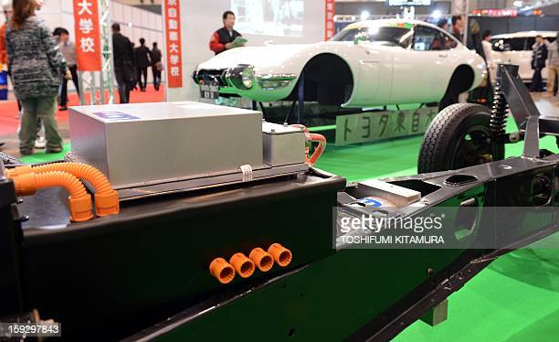 A battery and motor is set up on the original chassis of a 'Toyota 2000GT EV II' electric vehicle removed from a 1968 Toyota 2000GT by the Toyota...
