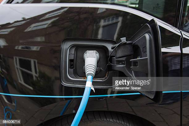 Battery charger in the black electric car